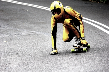 Downhill skateboarders are a special breed. The atmosphere at an event is like a surfing competition, only the waves are much less forgiving. They have hockey pucks attached to their gloves for breaks and no fear. This was taken at a world meet in Wollongong in 2012.